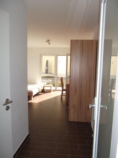 Ein Zimmer Wohnung mit zwei Eingängen